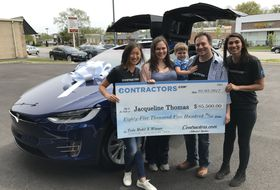 Contractors.com Awards Jacqueline Thomas with Tesla Model X